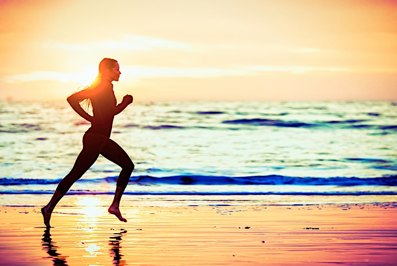A Woman Running at Beach